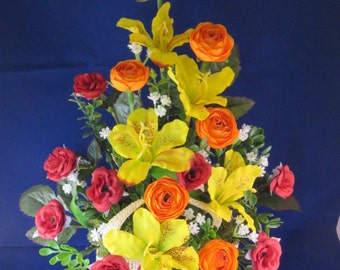 Artificial Flower arrangement in red hessian sack, red roses, yellow alstromeria  and orange rununculi, spring colours, perfect gift.