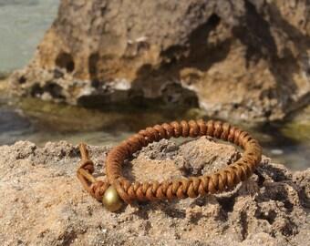 Bracelet knots for boy on Earth-colored waxed cotton. Man bracelet.