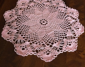 Set of two doilies in a pretty pink color! Crocheted with love.