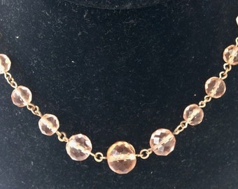 Salmon pink faceted glass necklace