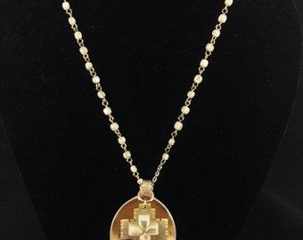 pearl cross in silver spoon necklace