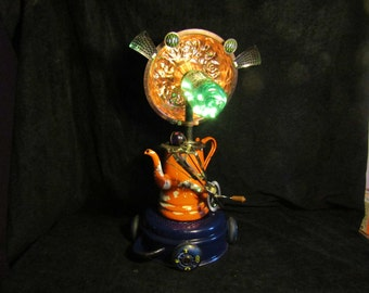 Coffee Pot,    Found Object,  Robot, Battery, L.E.D.  Accent Lamp Sculpture