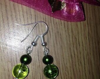Green glass dangle earrings on silver wires