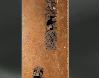 Oxidized iron wall sculpture