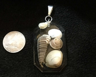 Tiny shells in rectangle resin pendant