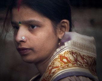 Young Woman in Varanasi at Dawn near the Ganges