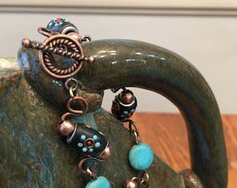 Bracelet of Southwest design with stone beads and copper