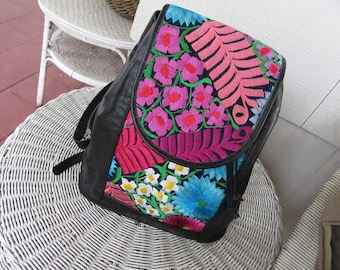 Beautiful handmade leather backpack with colorful embroidered flowers