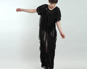 elegant transparent long maxi jersey dress made of structured fabric