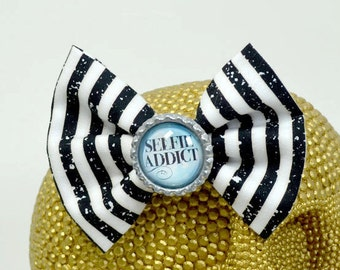 SELFIE ADDICT - Round Glass Dome cabochon on black and white striped fabric Hair Bow on Alligator Clip