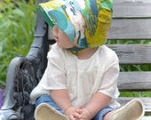 UB2 ENCHANTED GARDEN a gorgeous green & violet purple landscape with birds on a baby summer sun hat, by Urban Baby Bonnets (all sizes)