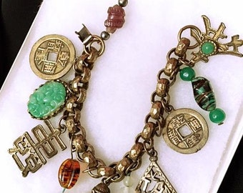 NAPIER 1950s Vintage Charm Bracelet Oriental Theme 50s Asian Influence with Ten (10) Charms Chunky Bracelet Mid Century Hammered Finish