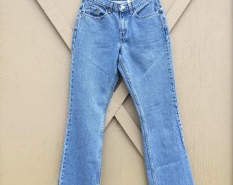 90s vintage Levi's 515 Medium Wash High Waist Boot Cut Jeans
