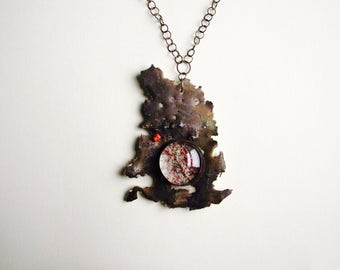 Bronze pendant with glass