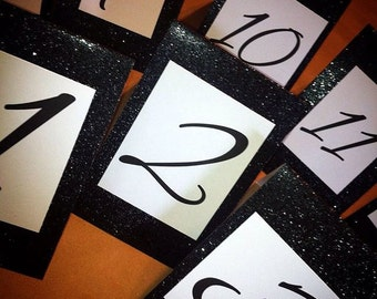 Sparkled tented table numbers