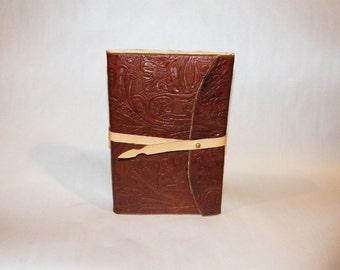 Embossed leather covered sketchbook/journal