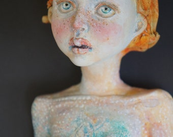 Koi the Golden Child scupture by artist Victoria Rose Martin