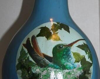 gourd planter or bird feeder with hummingbird in nest