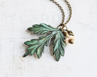 Aged Green Patina Leaf Necklace with Ivory Flower Bead on Antiqued Brass Chain, Rustic Nature Jewelry