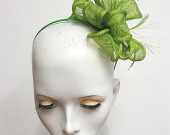 Greenery green sinamay and feather fascinator on ribbon covered headband