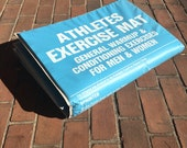 Vintage 1970s exercise floor mat - two sided padded sky blue vinyl with printed exercises - warmup and conditioning for men and women