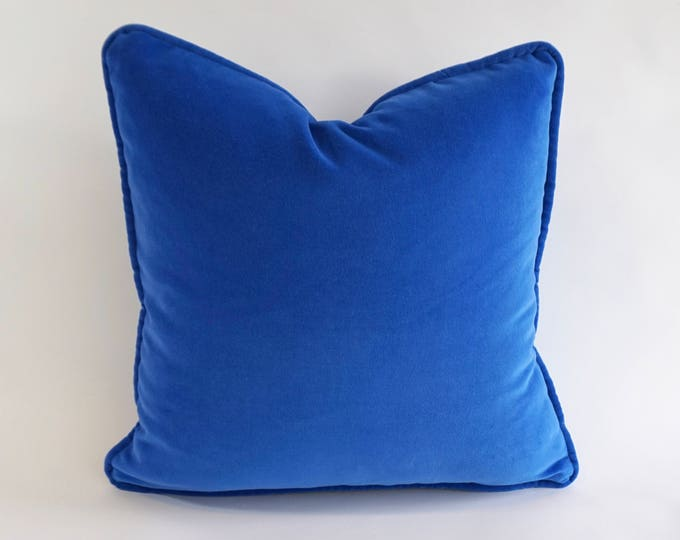Blues greens noraquinonez for Royal blue couch pillows