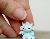 Tiny baby dragon in light turquoise - miniature pocket dragon