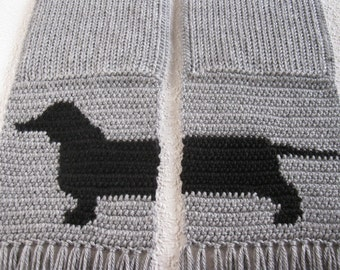 Dachshund scarf.  Gray crochet and knit scarf with a black wiener dog silhouette. Knitted scarves with dogs
