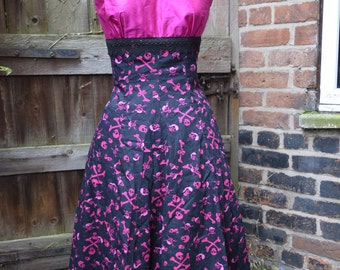 50's style shocking pink skull and crossbones dress