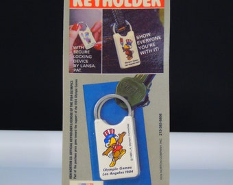 Keychain 1984 Los Angeles Olympic Games Sam the Olympic Eagle Keyholder with Locking Device Sealed Original Package