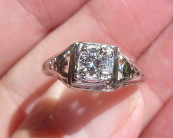 Beautiful Filligree in 18KT white gold with .25 point VS1 E  Diamond Engagment Ring
