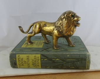 Vintage Solid Brass Lion Figurine, Hollywood Regency Statue, Lion with Emerald Eyes Figure