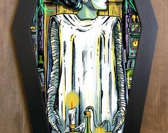 The Bride of Frankenstein coffin framed print.