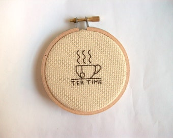 Tea Time mini cross stitch -- completed 3 inch round cross stitch about what time it is