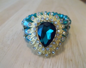 Reduced 3 Row Emerald Green Crystal Stretch Cuff Bracelet with a Gold Tone, Emerald Green and Clear Crystal Pendant