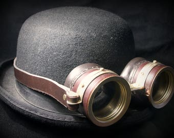 Steampunk goggles in dark brown leather and brass.