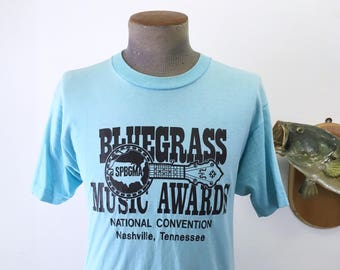 1970s BLUEGRASS MUSIC Awards T-Shirt Vintage Blue SPBGMA National Convention Nashville, Tennessee T Shirt by Screen Stars - Size Medium