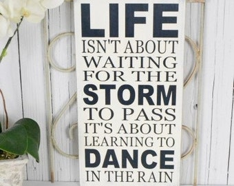 READY TO SHIP---   Life Isn't About Waiting For The Storm To Pass It's About Learning To, 9.5x18 Solid Wood Sign