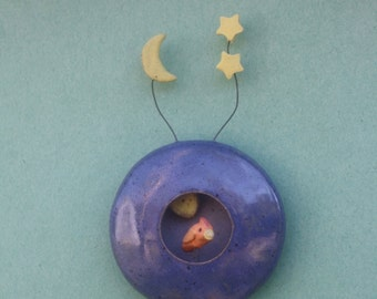 OOAK spherical stoneware disc with bird perched in opening beneath moon and stars