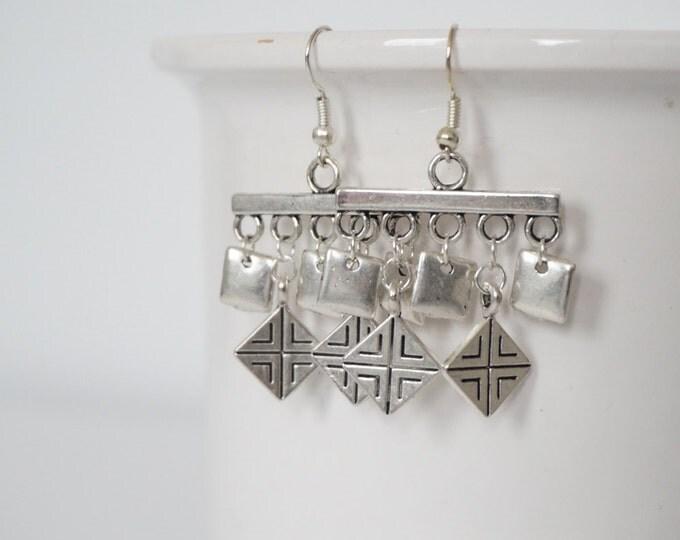 Earrings silver monkeys.