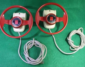 Vintage 1960's AMT Authentic Model Turnpike Power Steering slot car drive controllers.