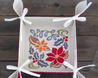 Fabric storage basket featuring a Christmas Floral design. Retro or vintage styling.