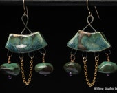 A Night in Wales, green earrings made of clay slabs with twisted steel, green turquoise and tiny chain hanging in catenary loops