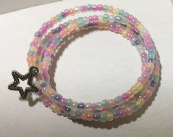Very sweet pastel beads with a silver star, 4 rows memory wire.