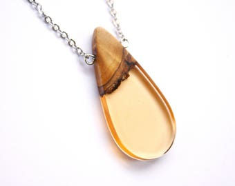 Tear drop shaped pendant / necklace handmade from Australian wood and pale orange resin