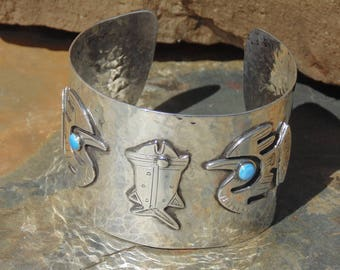 Graziella Laffi  ~ Vintage Peruvian Wide Sterling Hammered Cuff Bracelet with Fish and Birds with Blue Enameled Eyes