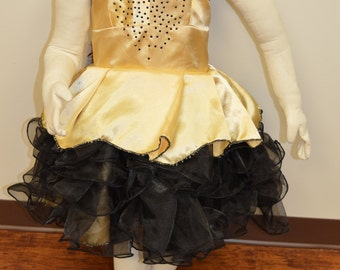 Gold satin girl's fancy dress with black tutu ruffled tulle skirt. Sleeveless with corset style back and rhinestone front. Party or pageant