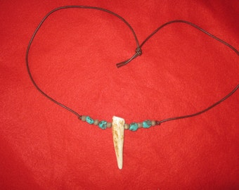 Deer Antler pendant on brown leather lace