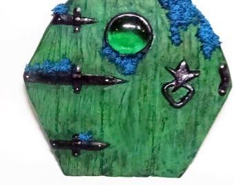 Green Fairy Door, green glass window, blue flowers. The old green door, water fairies.