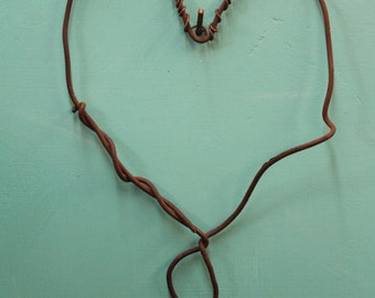 funky wire heart made from rusted found wire